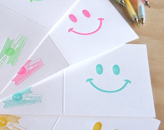 Letterpress x4 letterpress Smiley face cards, retro 80's style, in neon pink, neon green, turquoise blue, sunshine yellow.