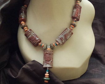 One strand carved jasper, spiny oyster, and turquoise necklace