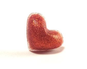 Glittery orange resin heart ring