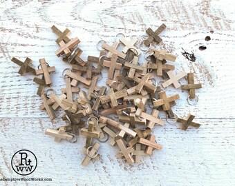 50 rustic cross pendants handmade from reclaimed tobacco barn wood