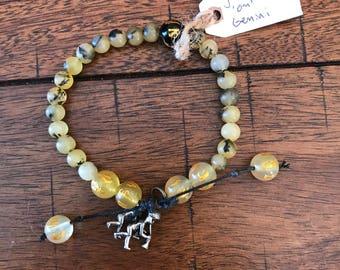 mala bracelet with yellow serpentine, om beads and gemini pendant (adjustable)