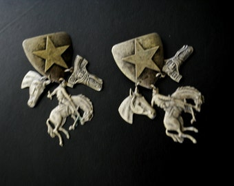 Cowboy vintage 80s light pewter , large, dangle, pierced  earrings.