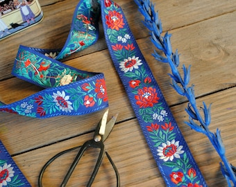 Czech colourful vintage embroidered braid with white, red flowers and green leaves on a blue background the braid Made in the 1970s.  104 cm