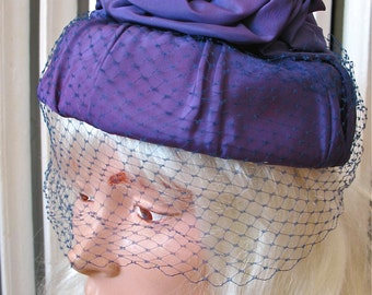 Violet Hour | Vintage 1960s Purple Faille Rosette Cocktail Hat Vintage Topper with Blue Veil