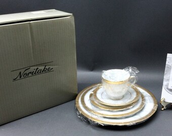 Nortake Five Peice Place Setting , Crestwood Gold No. 4167, in the original box. New