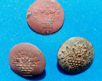 Three vintage brass buttons of the 19th century