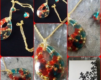 Necklace with large pendant of resin and earrings