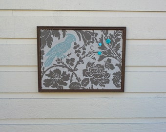 Linen Magnet Board, taupe and turquoise botanical print with a parrot image in a gold vintage frame and 3 turquoise cabochon magnets
