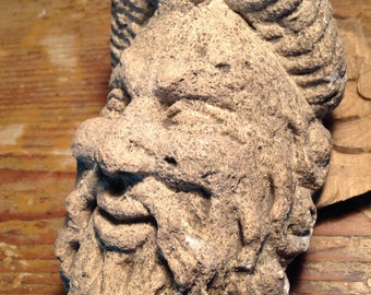 Stone carved bearded man's face