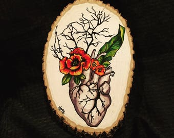 Anatomical Heart with Flowers on Wood Slice
