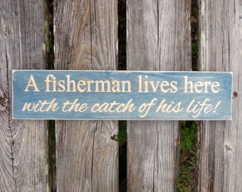 a fisherman lives here with the catch of his life sign,catch of his life,fisherman,fishing,fish,fisherman lives here,fishing sign,wood sign