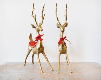 holiday brass deer, large brass deer figurines, vintage brass reindeer with red and gold velvet trim, Christmas decor, mid century