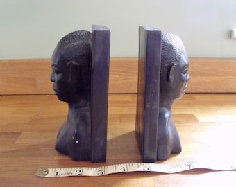 Vintage Tribal folk art. Ebony wood carvings in the form of book ends, Africa