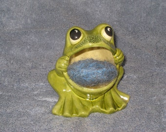 Brillo frog,  is 4 and one half inches tall x 4  inches  wide.
