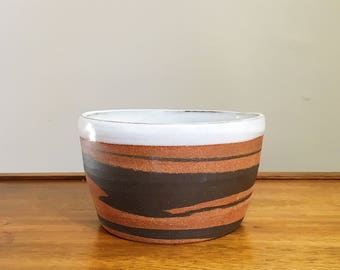 marbled dark brown and red clay ceramic bowl