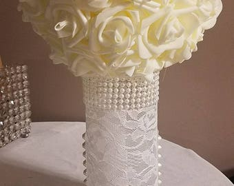 Pearl and lace covered vase.