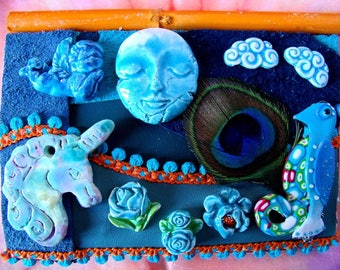 """Collage of leather on wood and ceramics, fantastic Creatures, """"under the Blue Moon"""""""