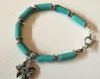 Turquoise Gemstone cylinder tube shape beads bracelet with charms.