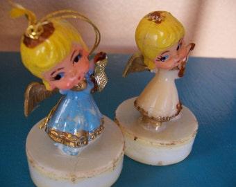 two tiny plastic angels