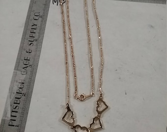 "Goldtoned 4 heart necklace 18"" used"