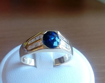 Ring 18K gold with blue sapphire and diamonds