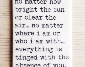 porcelain wall tag screenprinted text no matter how bright the sun or clear the air... no matter where i am or who i am with... -rumi