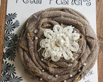 Burlap ribbon rose accented with a doily, pearl center and glass seed beads