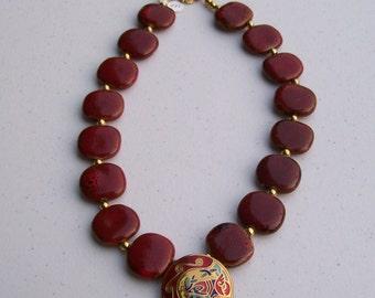 red porceline surprisew/ enamel pendant