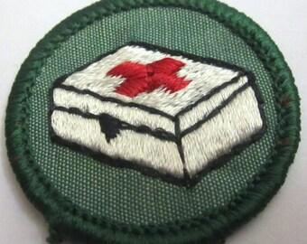 "Intermediate Girl Scout Badge ""1st Aid"" circa 1960's"
