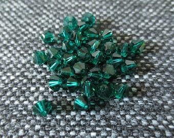 Set of 32 Swarovski bicone 5301 beads - 4 mm emerald green