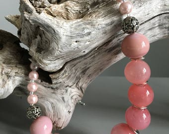 Beautiful feminine necklace in soft pastel pink color with hand blown glass beads complimented by pink pearls.