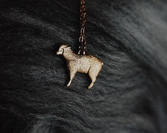 meadow. a tiny whimsical brass sheep necklace