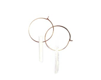 Rose gold hoops with white raw stone