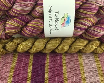 City Girl With Gold Heel and Toe - Hand-Dyed Self-Striping Sock Yarn