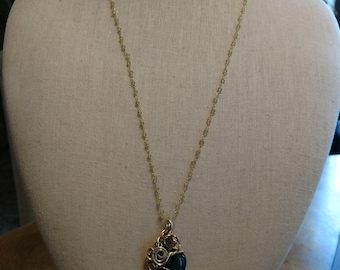 Green bloostone pendant necklace wire wrapped with gold colored copper wire with periodot beaded chain