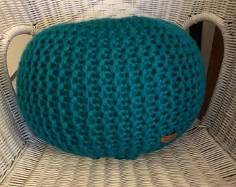 Hand knitted small pouffe/floor cushion/footstool.
