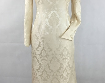 Ivory silk damask wedding dress, long sleeves, button back.