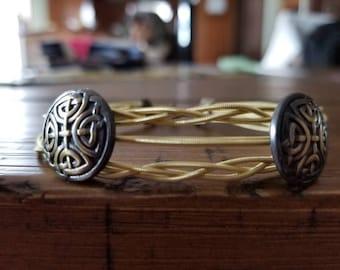 Braided and embellished guitar string bracelet