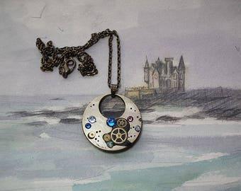 Steampunk  pendant : Gustav Klimt Style, pieces of watch Mecanism,cogs, black resin and blau & lilac Swarovski  cristal cabs