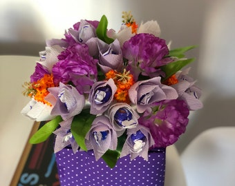 Handmade gift box decorated with tulips made from crep paper with candies in each flower.
