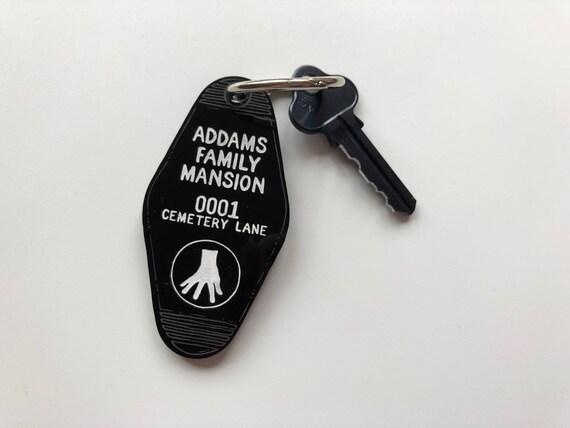 addam's family mansion cemetery lane keychain key