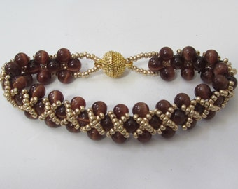Brown and Tan Glass Bead Bracelet with Gold Bead Embellishments and Gold Plated Clasp