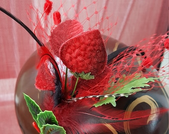 Red Christmas fascinator with red netting and velvet strawberries feathers and vintage Holly with berries
