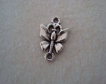 Between two silver coloured metal Butterfly