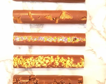 5 chocolate bars, honeycomb, brownie, salted caramel, sprinkles and biscoff