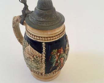 Vintage Beer Stein. Pottery base with pewter lid.