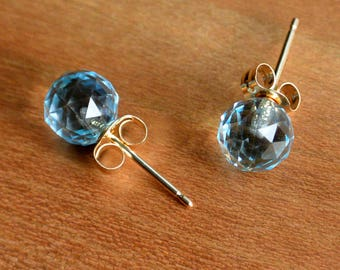 Faceted Blue Topaz Stud Earrings, 6 mm beautifully faceted Topaz bead studs, 14Kt Yellow Gold posts and ear-backs. Handmade in the USA