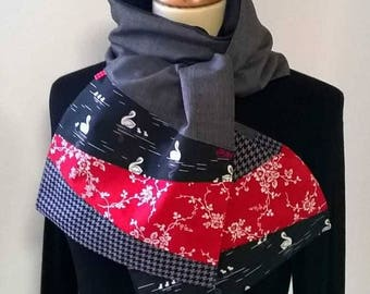 Scarf in grey, red and black fabrics.