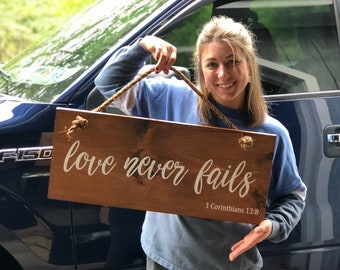 Love Never Fails Hanging Sign