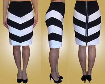 Stripy, navy, ivory, white, blue pencil skirt, zip fastening at the back. Sizes UK 8, 10, 12 / US 4, 6, 8